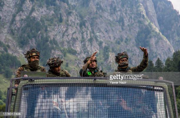 Indian army convoy carrying reinforcement and supplies, drive towards Leh, on a highway bordering China, on September 2, 2020 in Gagangir, India....