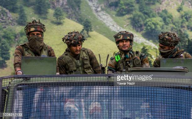 Indian army convoy carrying reinforcements and supplies, drive towards Leh, on a highway bordering China, on September 2, 2020 in Gagangir, India....