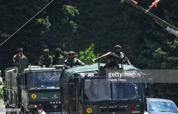 Indian Army convoy moves along SrinagerLeh Ladakh national highway in Sonmarg area of Ganderbal District following deadly clashes along the disputed...