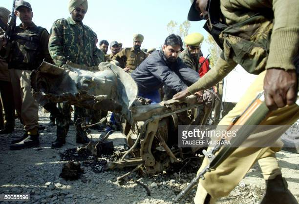 Indian army examine the remains of a car after a car bomb explosion in the Nowgam area on the outskirts of Srinagar 02 November 2005 A suicide bomber...