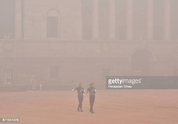 Indian army jawan march at Rashtrapati Bhawan on smoggy morning on November 7 2017 in New Delhi India Delhi woke up to a thick brown haze this...