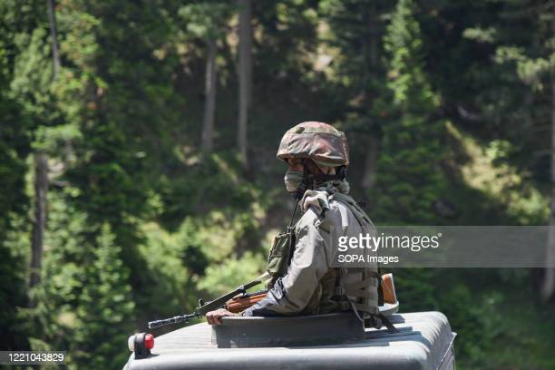 Indian army man keeps vigil from top of armored vehicle as they moves on national Highway leading towards Ladakh India and China held talks again on...