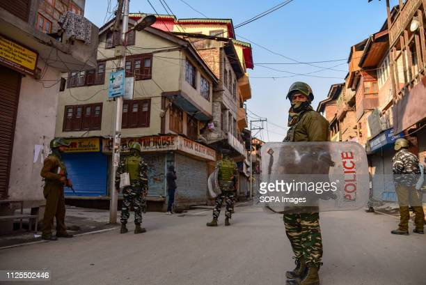 Indian army men are seen standing on guard after the protest in Srinagar Traders in Lal Chowk and adjoining markets closed their shops on 16 February...