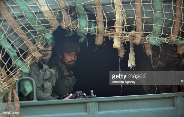 Indian army men move towards the gun battle site in Humhama on the outskirts of Srinagar the summer capital of Indian controlled Kashmir on October...