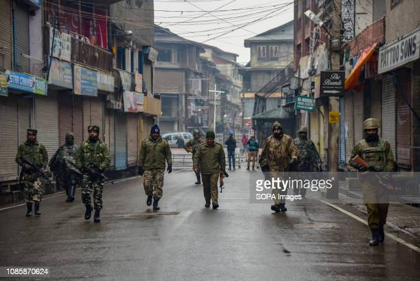 Indian army men seen patrolling the street of Srinagar during restrictions. Kashmiris mark 29th anniversary of Gaw Kadal massacre. More than 50...