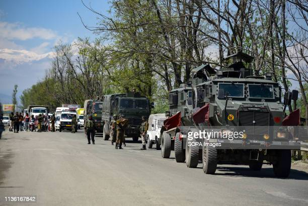 Indian army men seen standing alert as the Indian army convoys moves on the National Highway on the outskirts of Srinagar The Indian authorities on...