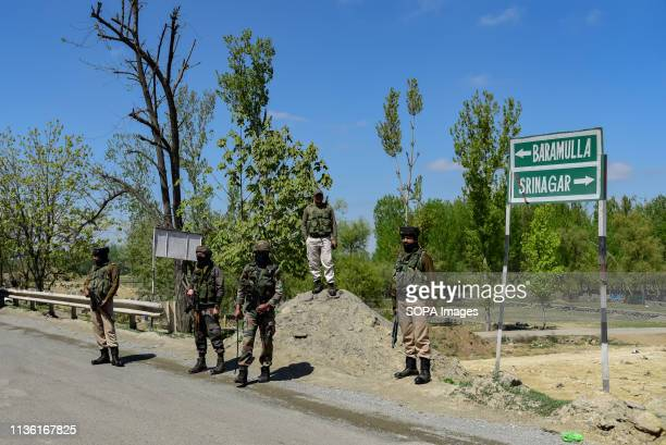 Indian army men seen standing alert to safeguard the movement of Indian convoys at the National Highway on the outskirts of Srinagar The Indian...