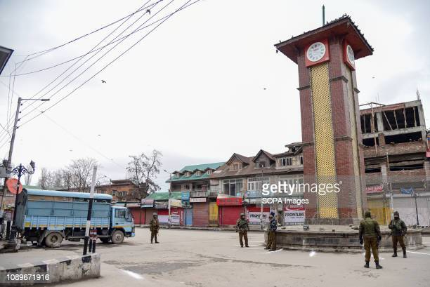 SRINAGAR KASHMIR INDIA SRINAGAR JAMMU KASHMIR INDIA Indian army men seen standing guard in front of the clock tower at city center during...