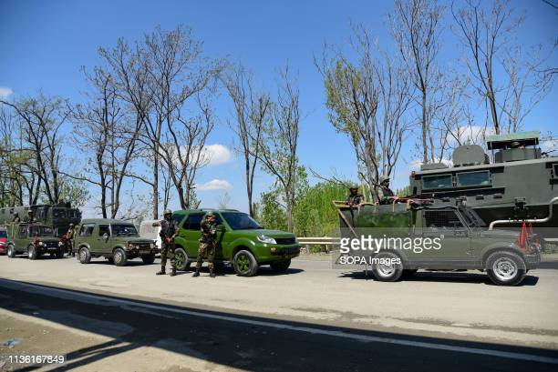 Indian army men seen standing on guard as the former Chief Minister Omer Abdullah Protests against civilian traffic ban on National Highway on the...