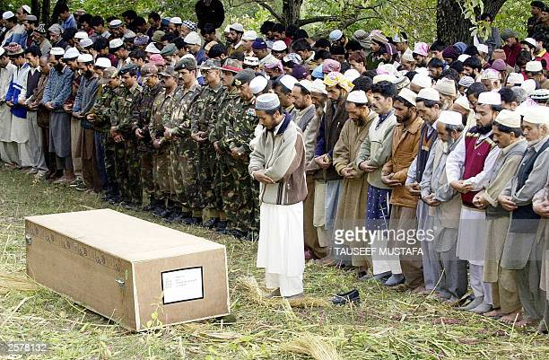 Indian Army officers and Indian Kashmiri Muslim men offer funeral prayers at the funeral of Mohammad Shafi Lone an Indian Army soldier at Uri 102 kms...