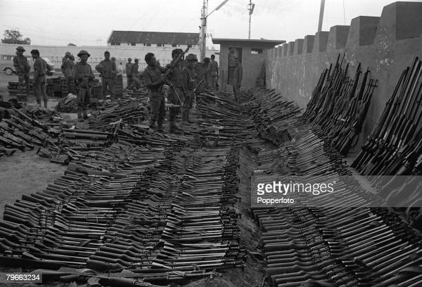 India-Pakistan War, 21st December 1971, Indian army officers examine some of the weapons taken from Pakistan troops in Dacca, East Pakistan, after...