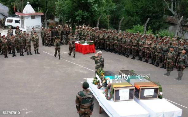 Indian Army officers pay their respects during a ceremony for two soldiers killed on the Line of Control in Krishna Ghati in Poonch some 220kms from...