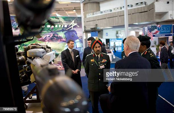 Indian Army officers with the Ministry of Defense listen to a Lockheed Martin weapons salesman 2nd right explain the Hellfire missile system February...