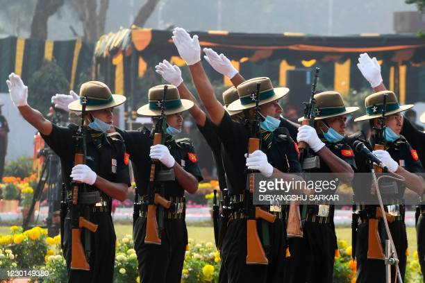 """Indian army officials perform during a ceremony to mark """"Vijay Diwas,"""" which commemorate the victory over Pakistan during the 1971 war that led to..."""