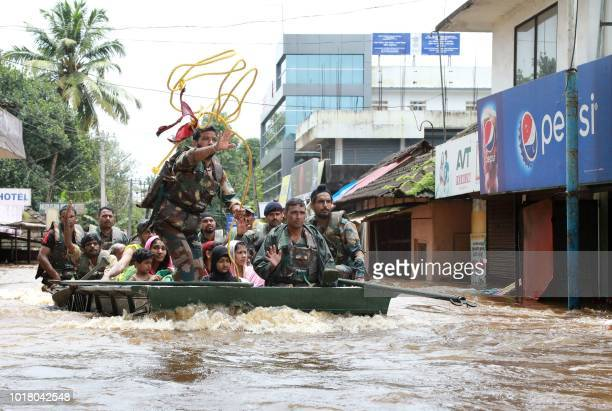 Indian army personal evacuate local residents in a residential area at Aluva in Ernakulam district in the Indian state of Kerala on August 17 2018...