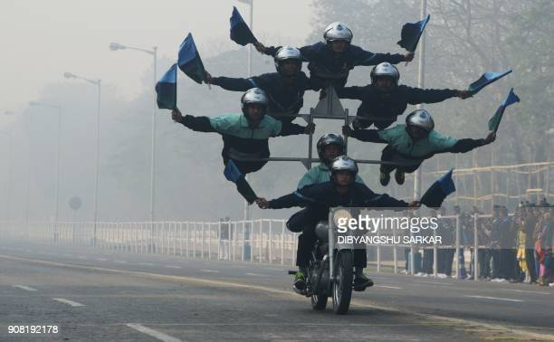TOPSHOT Indian army personel perform acrobatics on their bikes as they take part in a rehearsal ahead of the forthcoming Republic Day parade in...