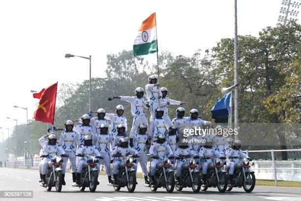 Indian army personel perform acrobatics on their bikes as they take part in a rehearsal ahead of the forthcoming Republic Day parade in Kolkata on...
