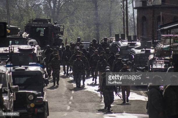 Indian army personnel are seen near the gunfight site Wednesday April 11 in Khudwani village about 60 kilometres south of Srinagar Indianadministered...