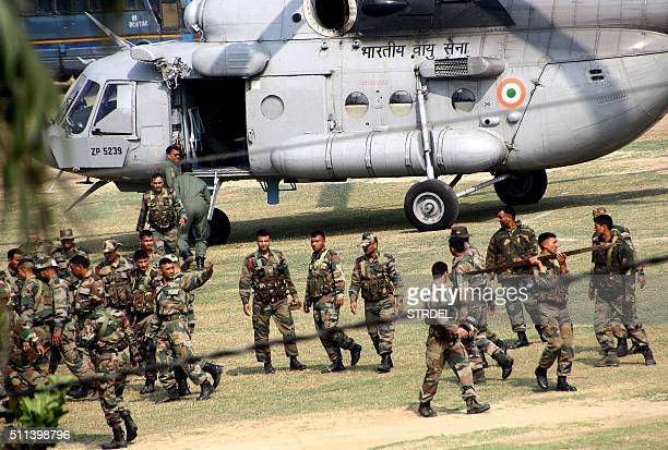 Indian Army personnel arrive following fatal caste protests in Rohtak on February 20 2016 Indian authorities issued shootonsight orders and deployed...