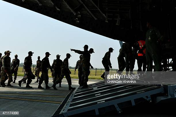 Indian Army personnel board an Indian Air Force aircraft containing relief materials to be airlifted to Nepal to provide assistance to earthquake...