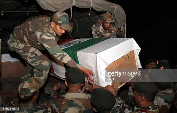 Indian army personnel carry a coffin of one of the Indian army soldierS who were killed during an ambush at Brigade headquarters in Poonch about 240...