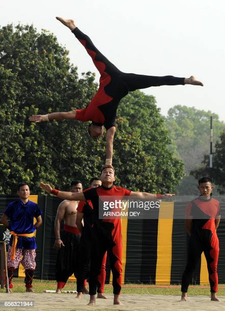 Indian army personnel display their acrobatic skills at a ceremony in Agartala on March 22 ahead of the start of a joint IndoBangladesh Army cycling...