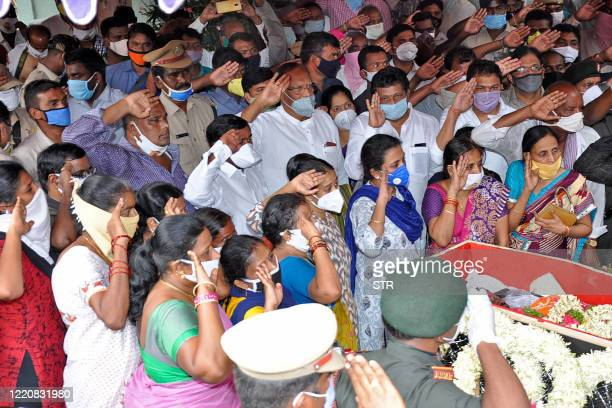 Indian Army personnel, family members and relatives salute next to the body of Colonel Santosh Babu, who was killed in a clash with Chinese forces in...