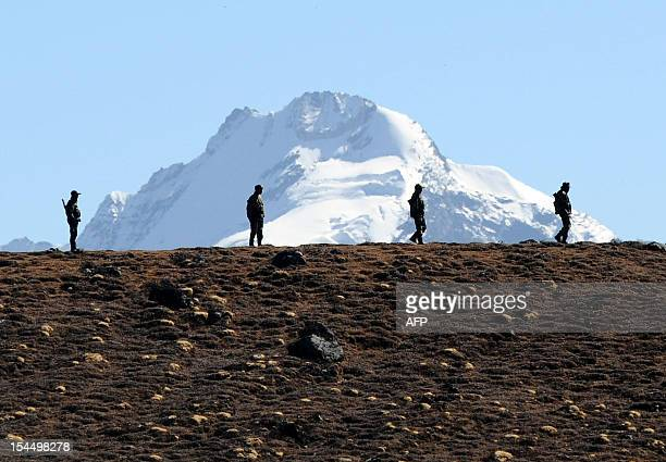 Indian Army personnel keep vigilance at Bumla pass at the IndiaChina border in Arunachal Pradesh on October 21 2012 Bumla is the last Indian Army...