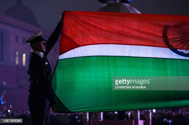 Indian Army personnel lower India's national flag during the rehearsal at the Beating Retreat Ceremony at Vijay Chowk in New Delhi on January 24 2019...