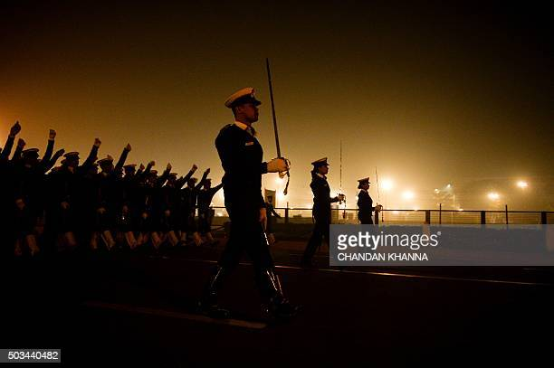 Indian Army personnel march during a rehearsal for the forthcoming Republic Day parade on a foggy winter morning at Rajpath in New Delhi on January 5...