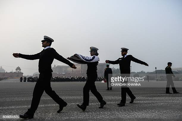 Indian Army personnel march with the national flag during rehearsal at the Beating Retreat Ceremony at Vijay Chowk in New Delhi on January 19 2016...