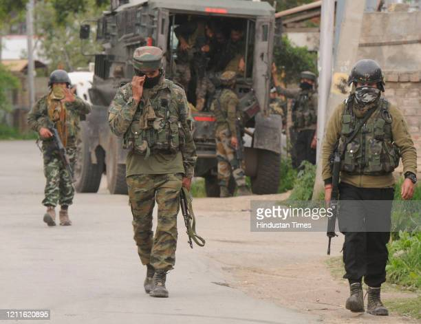 Indian Army personnel near the site of an encounter in Pulwama district on May 2 in Srinagar India Two unidentified militants were killed in an...