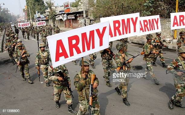Indian Army personnel patrol following fatal caste protests in Rohtak on February 20 2016 Indian authorities issued shootonsight orders and deployed...