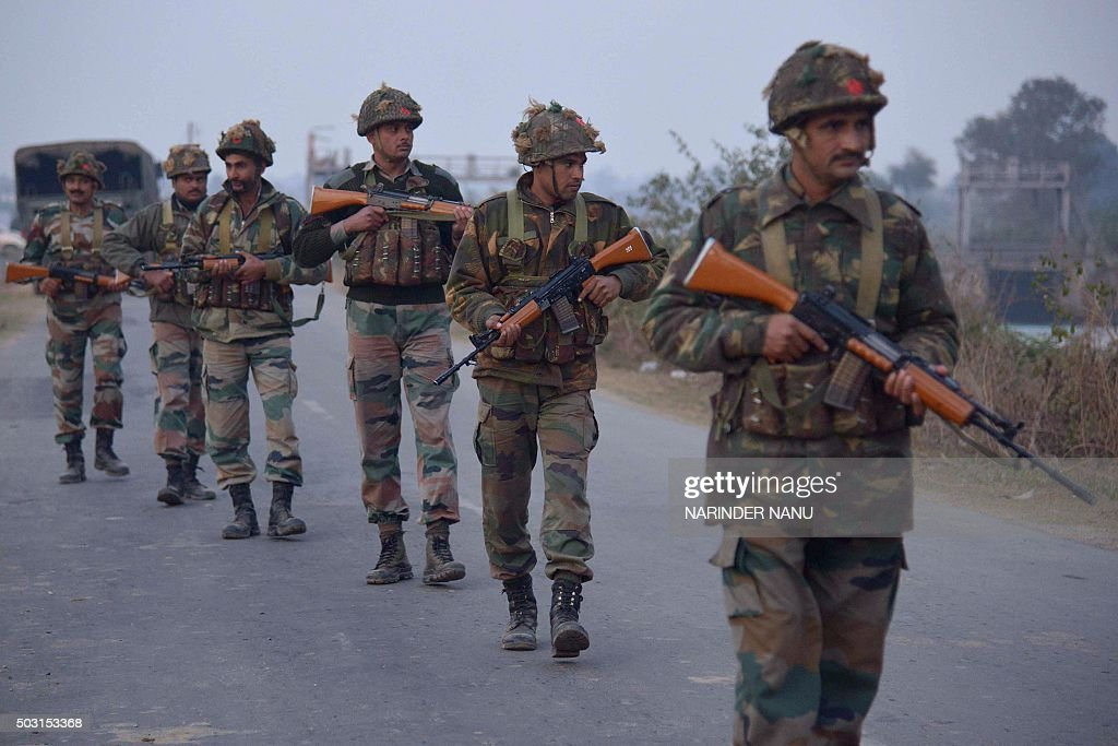 Indian Army personnel patrol near the Air Force Base in Pathankot on January 2 2016 during an ongoing attack on the base by suspected militants A...