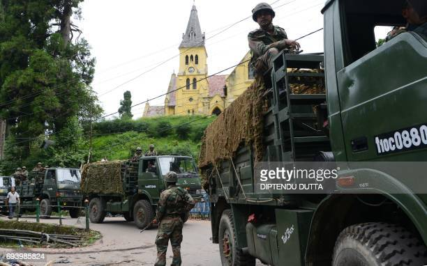 Indian army personnel patrol the streets after clashes between police and supporters of The Gorkha People's Liberation FrontGJMM in Darjeeling West...