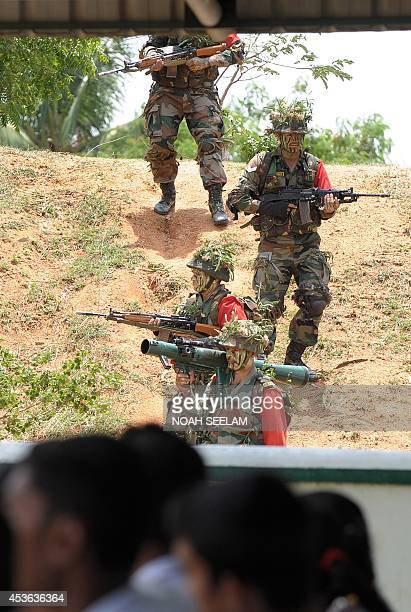 Indian army personnel perform Skirmish Order Fire Demo during the 35th Raising Day celebrations of Batticaloa Brigade on the occasion of the 68th...