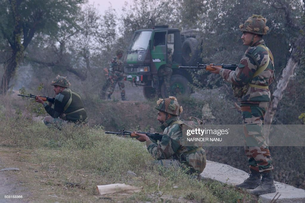 Indian Army personnel stand alert near the Air Force Base in Pathankot on January 2 2016 during an ongoing attack on the base by suspected militants..