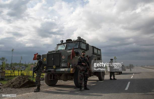 Indian army personnel stand in guard near the gunfight site Wednesday April 11 in Khudwani village about 60 kilometres south of Srinagar...
