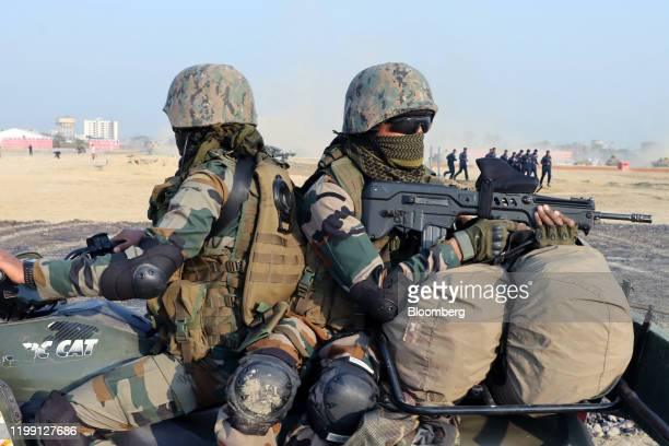 Indian Army solders on a quadbike perform an operation demonstration during the DefExpo 20 in Lucknow Uttar Pradesh India on Wednesday Feb 5 2020...