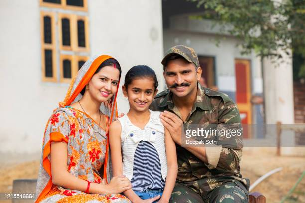 indian army soldier back to home stock photo - indian military stock pictures, royalty-free photos & images