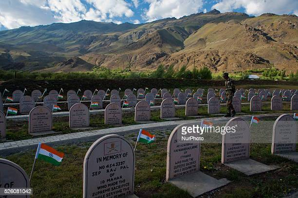 Indian army soldier walks in a war memorial for the killed Indian soldiers on July 30 2015 in Drass 142 km east of Srinagar the summer capital of...