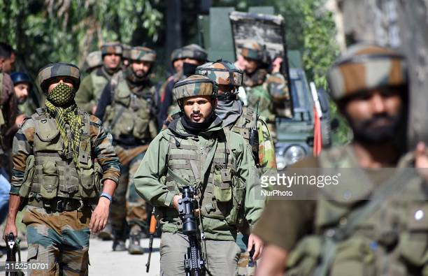 Indian army soldiers are seen near the site of gunbattle in Checkpora area of Budgam district on June 282019One militant was killed when a gunbattle...