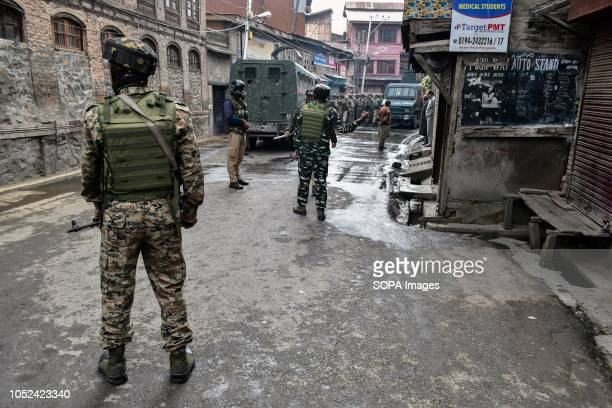 Indian army soldiers are seen on guard during the clashes Clashes broke out between militants and government forces in Srinagar The government forces...