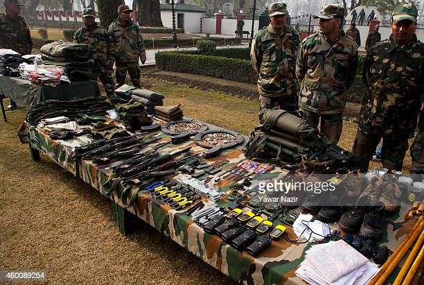 Indian Army soldiers arrange seized arms and ammunitions recovered in Uri near the ceasefire line or Line of Control that divides Kashmir between...