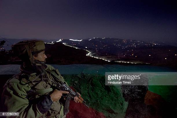Indian Army soldiers at forward posts beyond the illuminated fence on September 28 2015 in Hamirpur area near Bhimber Gali India The term Line of...