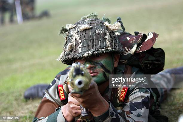 Indian Army soldiers demonstrate combat skills during the Army Day parade at Delhi Cantt on January 15 2015 in New Delhi India Every year Indian Army...