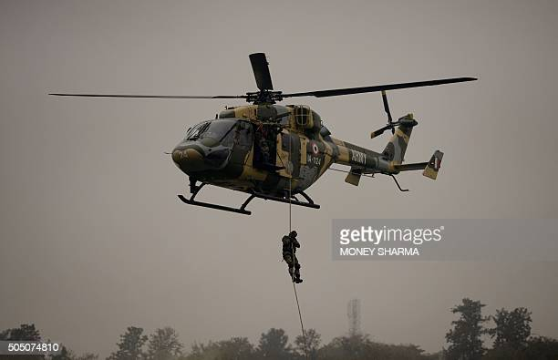 Indian Army soldiers demonstrate combat skills during the Army Day parade in New Delhi on January 15, 2016. The Indian army celebrated the 67th...