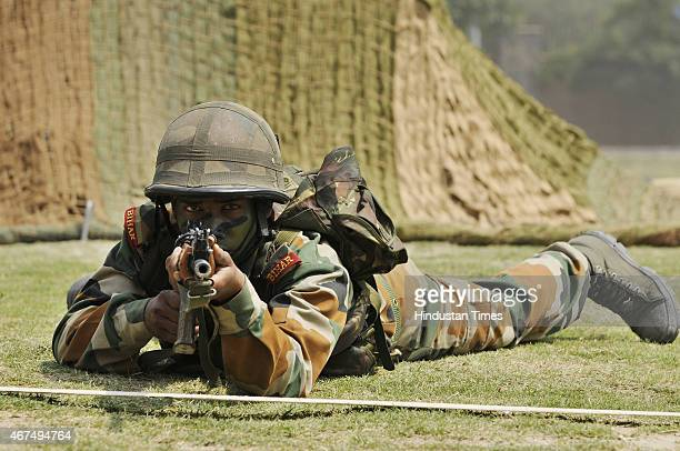 Indian Army soldiers demonstrate their skills during mock drill and battle field conditions in front of the students on the second consecutive day at...