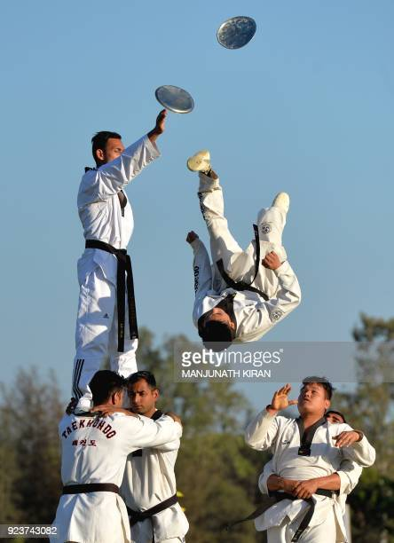 Indian army soldiers display martial art skills at an event organised by the Indian Army's ASC Centre and College in Bangalore on February 24 2018...