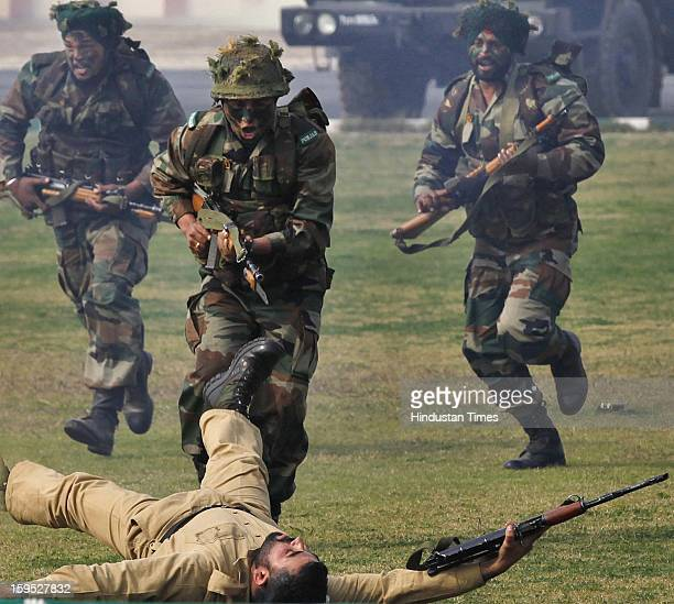 Indian Army soldiers display their combat skills during the Army Day parade At Delhi cant on January 15 2013 in New Delhi India The 65th anniversary...